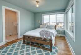 The 2nd bedroom in Unit 1 includes a queen-size bed and access to the shared full bath.