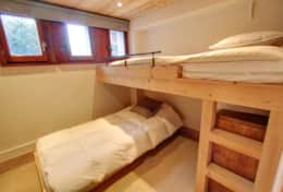 A lower ground twin bedroom with bunk beds