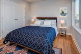 Unit 2 boasts a master bedroom with a queen-size bed.