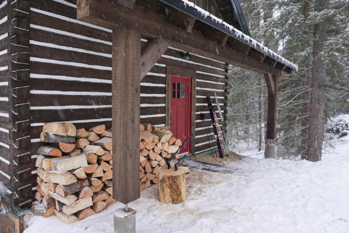 Front porch with firewood to stoke a cozy fire and plenty of room for skis and bikes!