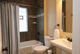 Main level bathroom is a full bathroom with tub and shower. Great lighting and ventilation.
