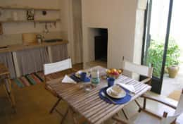 Azzurra - dining area towards the bathroom and french door onto a small courtyard- Depressa - Salent