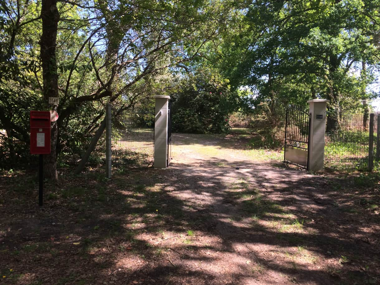 Gated entrance at end of a 1.5 km driveway