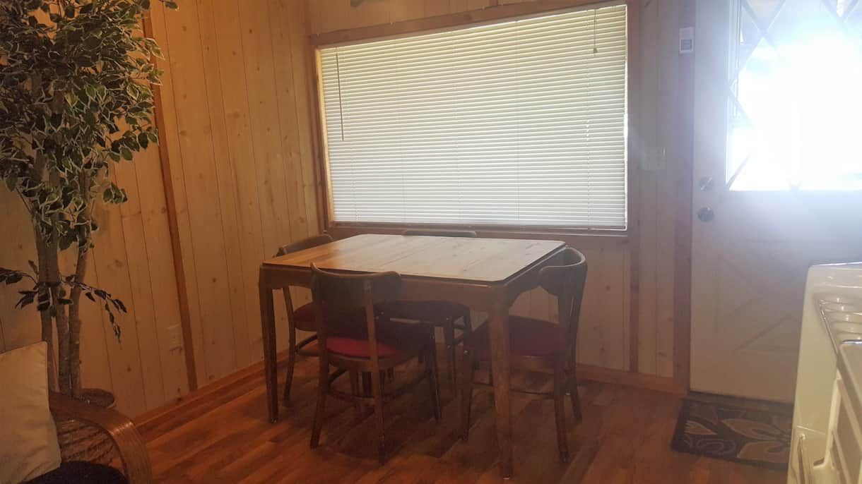 Dining room table with views of Mille Lacs