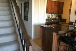 Fully stocked kitchen with dishwasher, refrigerator and electric oven/stovetop.