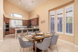Beautiful dining room with multiple seating areas