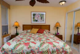 Maui Banyan, king size bed with designer bedspread, and quality linens.