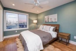 The master bedroom in Unit 3 is outfitted with a queen-size bed, closet, and en-suite bath.