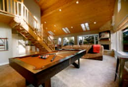 With a pool table, fireplace, TV, and cozy sofa, the great room is a wonderful space to hang out