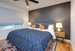 The master suite in Unit 4 is outfitted with a king-size bed, walk-in closet, and en-suite bath.