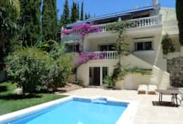 Villa Maxine 5 view of rear of garden & pool from far corner of patio