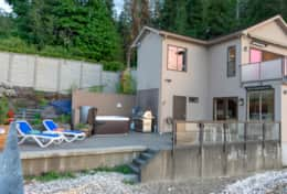 Luxury Lookout Hood Canal Vacation Rental outdoor patio with hot tub, sun chairs, fire pit and bbq