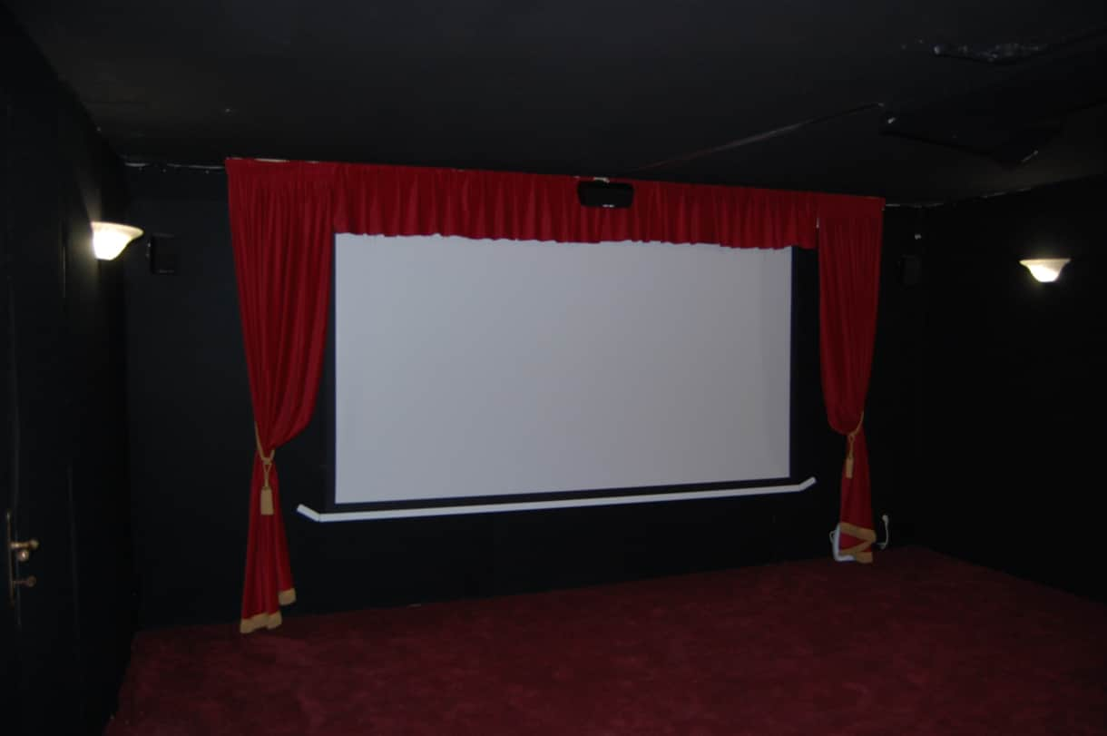 The retro cinema room with bluray projector, surround sound and a 10 foot screen.