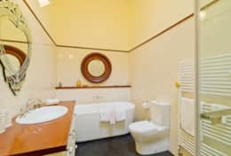 Bathroom with huge bathtub and heating rails for towels