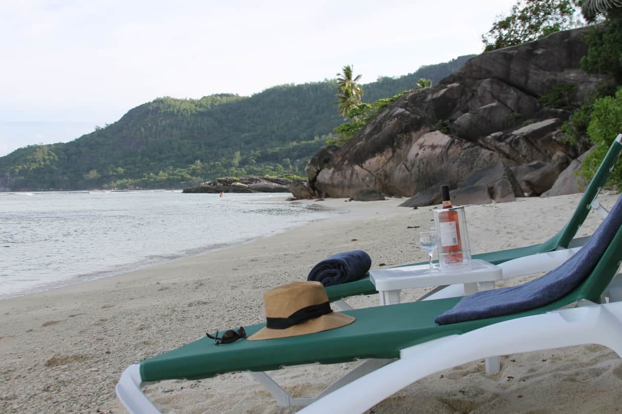 Enjoy 1 of Seychelles' best beaches on our sun loungers...