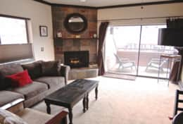 Studio side of condo with view of slopes, gas fireplace, large balcony