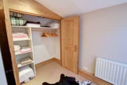 with plenty of storage space in built-in wardrobe